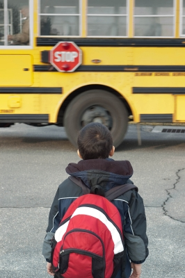 Young child waiting for school bus