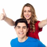 Couple giving thumbs-up