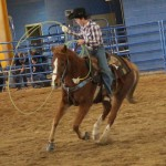 warming up horse before rodeo event