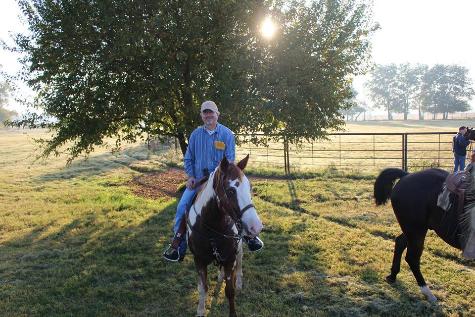 joe pote riding a paint horse